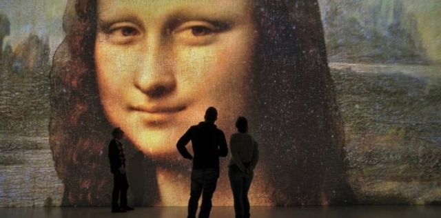 Mona Lisa art work covering an entire wall is not the real picture