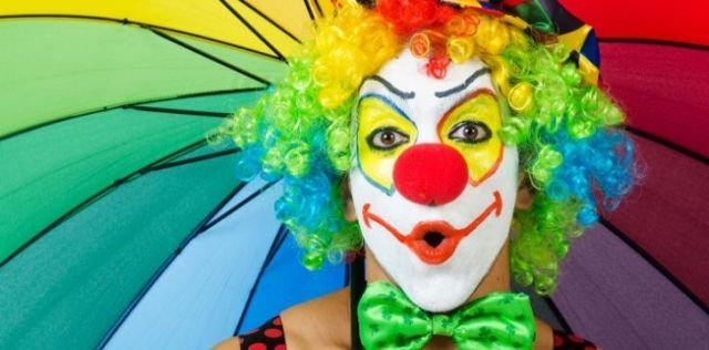 A clown with exaggerated makeup