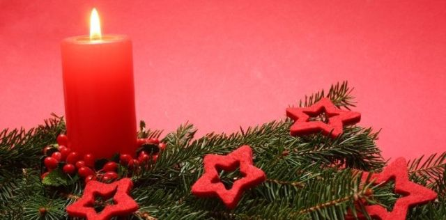 Red candle on a Christmas tree branch