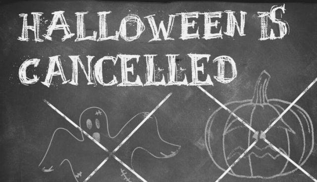 """""""Halloween is cancelled"""" written on a chalk board"""