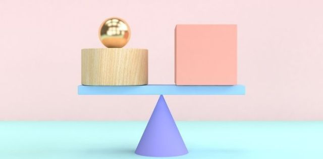Blocks being balances on a scale