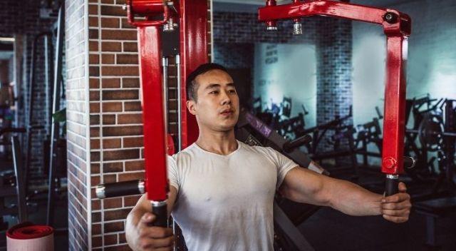 A man using a weight training machine