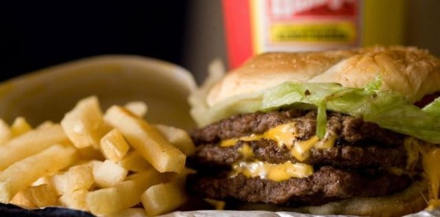 A delicious Wendy's meal with a burger, french fries and a soda