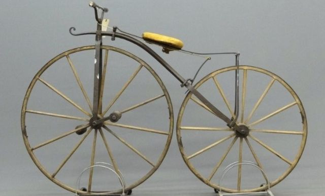 A golden boneshaker bicycle