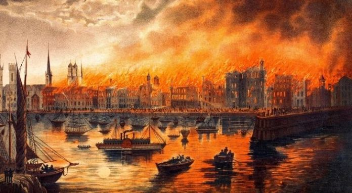 An artist impression of the Great Chicago Fire with many buildings on fire