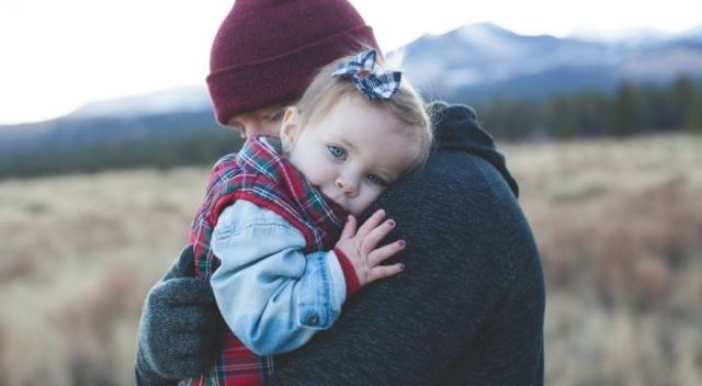 A father hugging his young daughter toddler