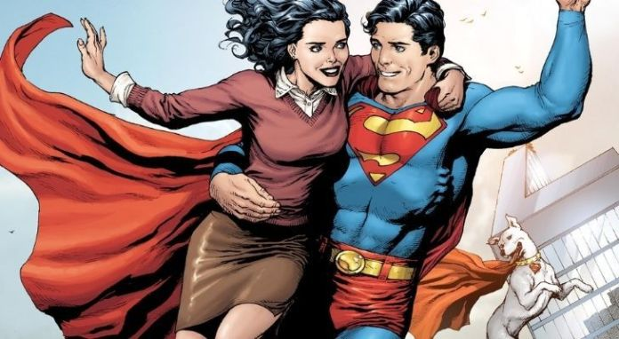 Superman holding his lover Lois Lane