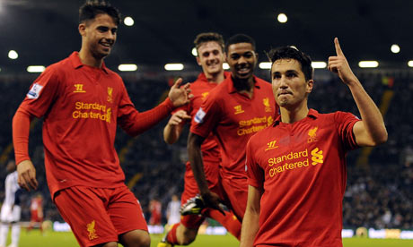 Nuri Sahin, right, after scoing the winner for Liverpool against West Brom in the Capital One Cup