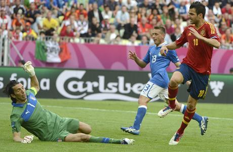 cesc-fabregas-of-spain-scores-against-italian-keeper-gianluigi-buffon-at-euro-2012-570662524
