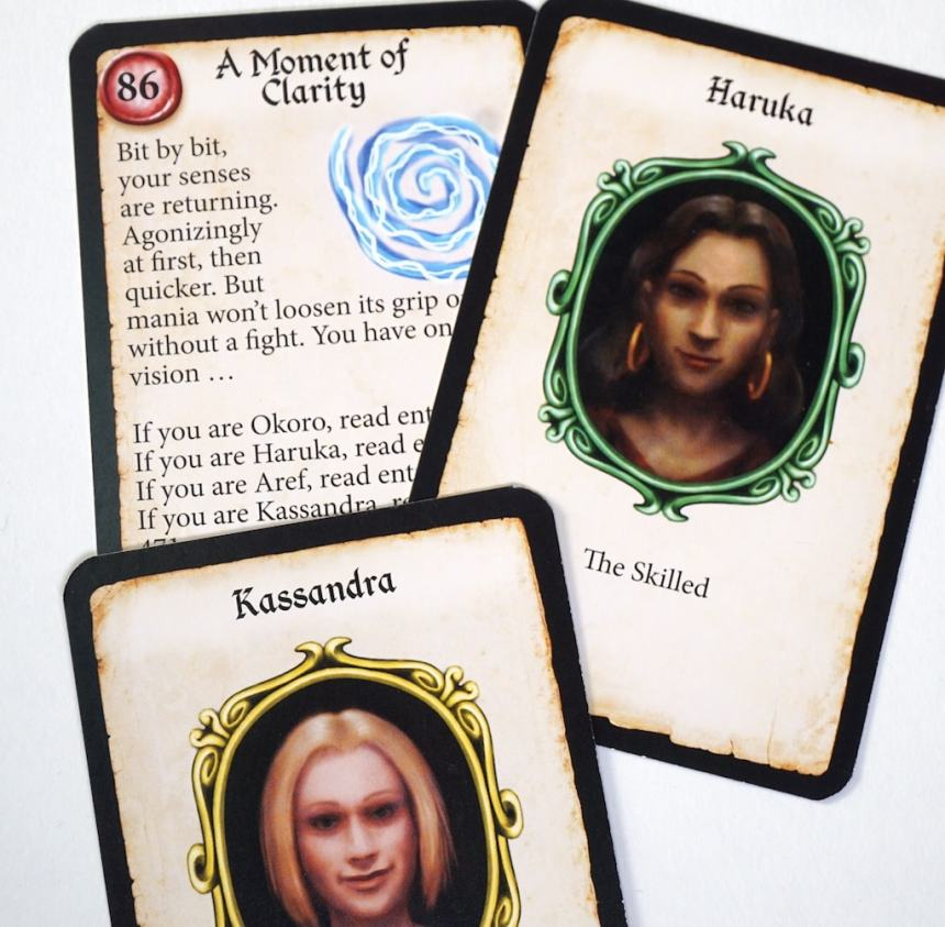 """Card """"A Moment of Clarity"""" is partially obscured by character cards Haruka and Kassandra - Bit by bit, your senses are returning. Agonizingly qat first, then quicker. But mania won't loosen its grip on... without a fight.If you are Okoro, read... If you are Haruka, read... If you are Aref, read... If you are Kassandra..."""