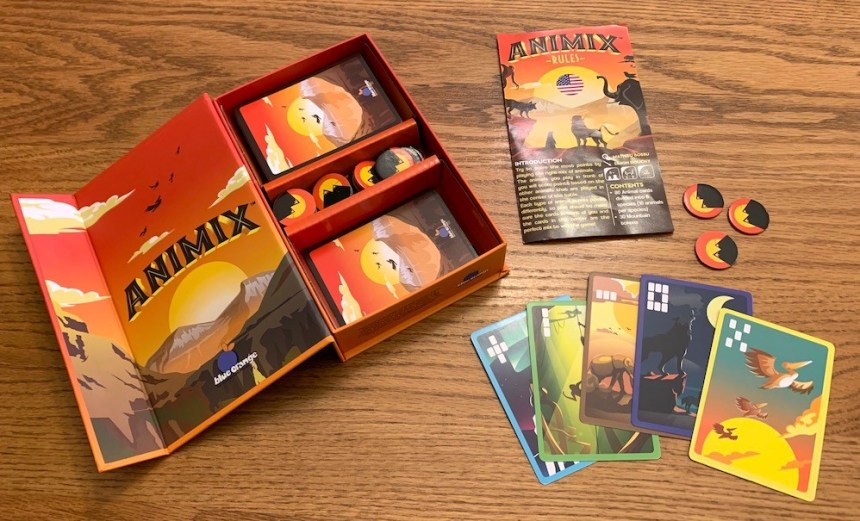 Animix open box with rule pamphlet, mountain tokens, and 5 animal cards