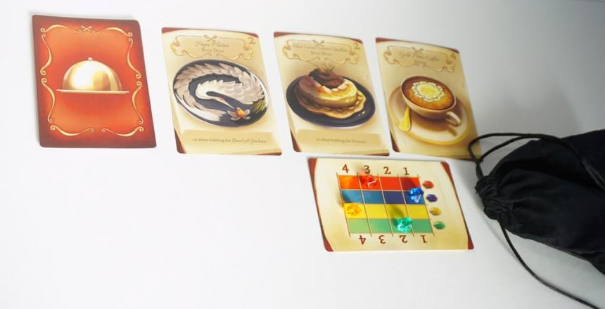 "3 Dish cards. Underneath, the ""gem value"" card, currently set to: red 3, blue 1, yellow 4, green 2."