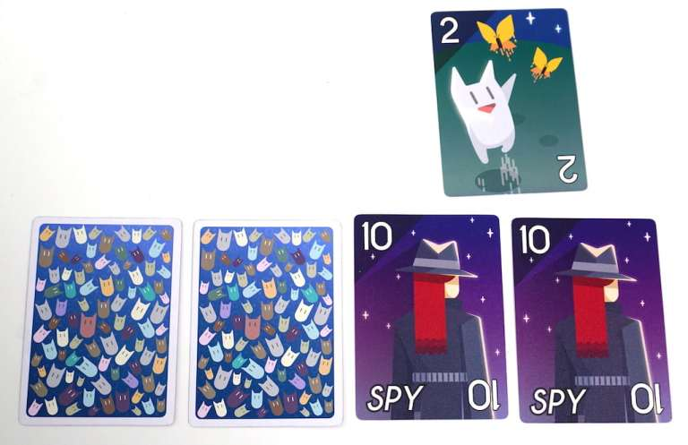 Two 10s are revealed, with a 2 card above them.