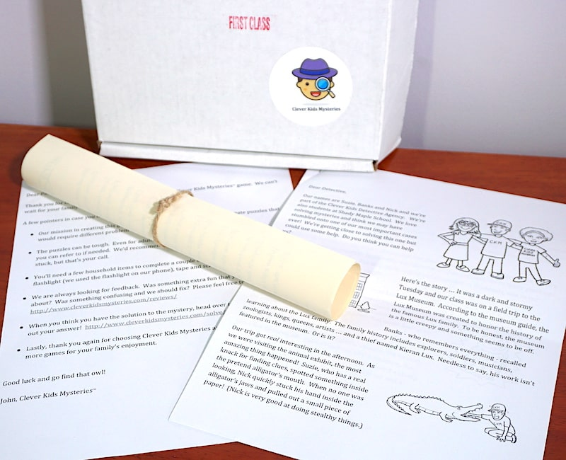 Our Clever Kids Mystery starts with a white box, an illustrated letter, and a parchment tied with string