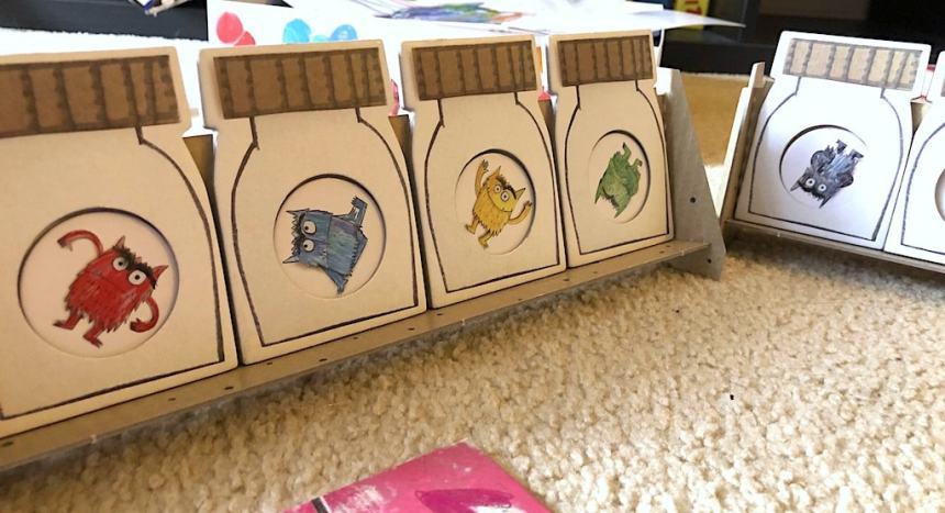 cardboard bottles for The Color Monster game