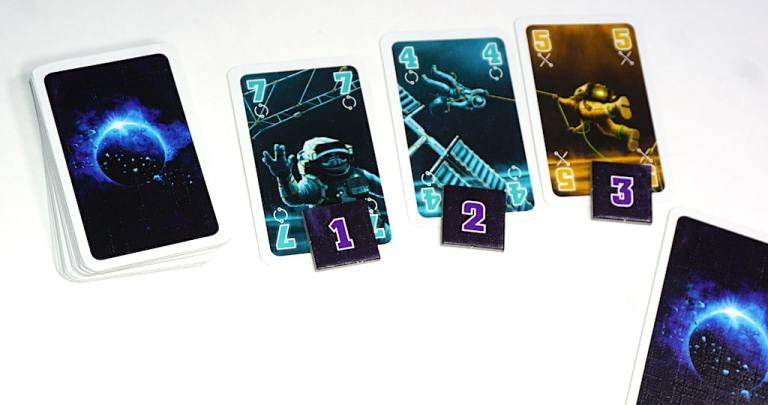 Task cards: Blue 7 with a 1 token, Blue 4 with a 2 token, Yellow 5 with a 3 token