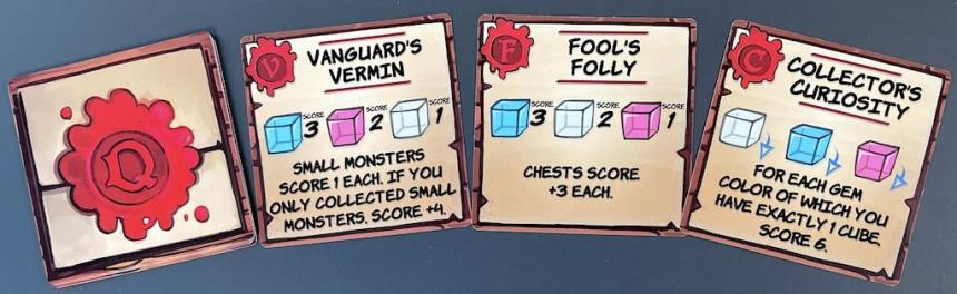 Dungeon Drop quest cards: Vanguard's Vermin - small monsters score 1 each. If you only collected small monsters, score +4. Fool's Folly - chests score +3 each. Collector's Curiosity - for each gem color of which you have exactly 1 cube, score 6.