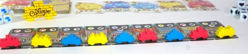 Red, yellow, and blue cars lined up on crowd cards.