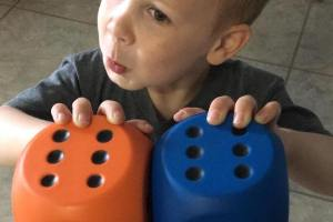 boy holding large dice