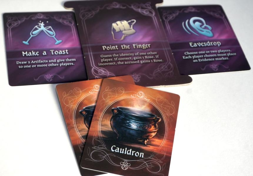 Actions: Make a Toast, Point the Finger, Eavesdrop. Pair of Cauldron Artifact cards.