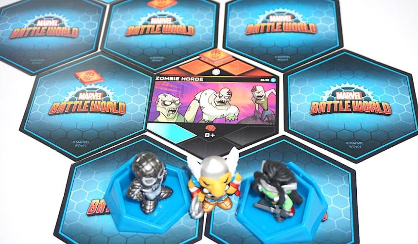 Marvel Battleworld layout. Zombie Horde in the middle is face-up. Other cards are face down.