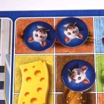 Mouse tokens on carrot, carrot, bread squares.