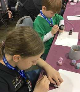 Children painting miniature soldiers