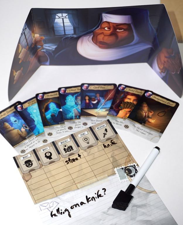 "Player screen, cards, and a eraseable board. There is writing on the board: ""Where - street, Weapon - knife. Falling on a knife?"""