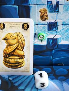 green penguin, die showing 1, and card showing a treasure that is one space away