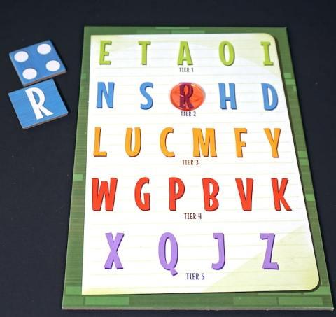 "Board full of letters. ""R"" has a token on it."
