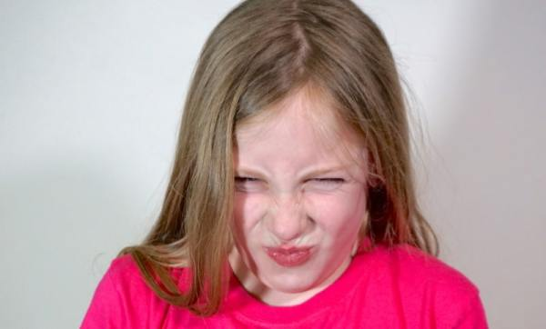 Child making a puckered, angry face