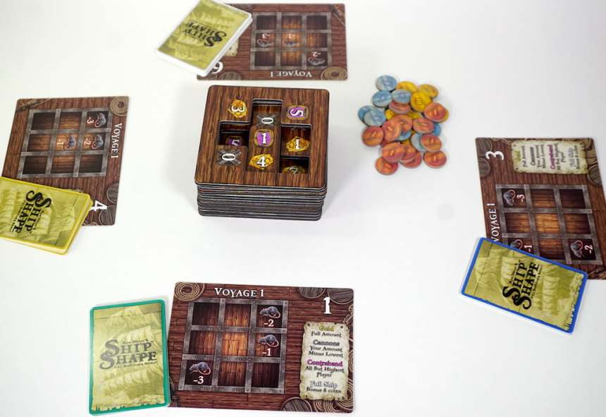 Central stack of 2d crates, with four hold boards and a stack of cardboard coins