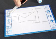 Hand drawing a letter and a mailbox
