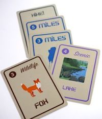 10 Essentials scoring cards: miles, scenic lake, wildlife fox