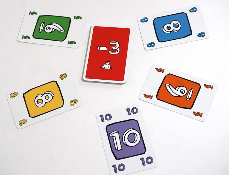 Center: -3 point card. Clockwise from top right: blue 8, orange 6, purple 10, yellow 8, green 6.