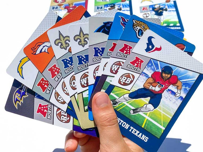 Hand holding 9 cards showing NFL teams & positions