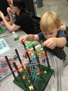 two year old playing Spider's Cradle
