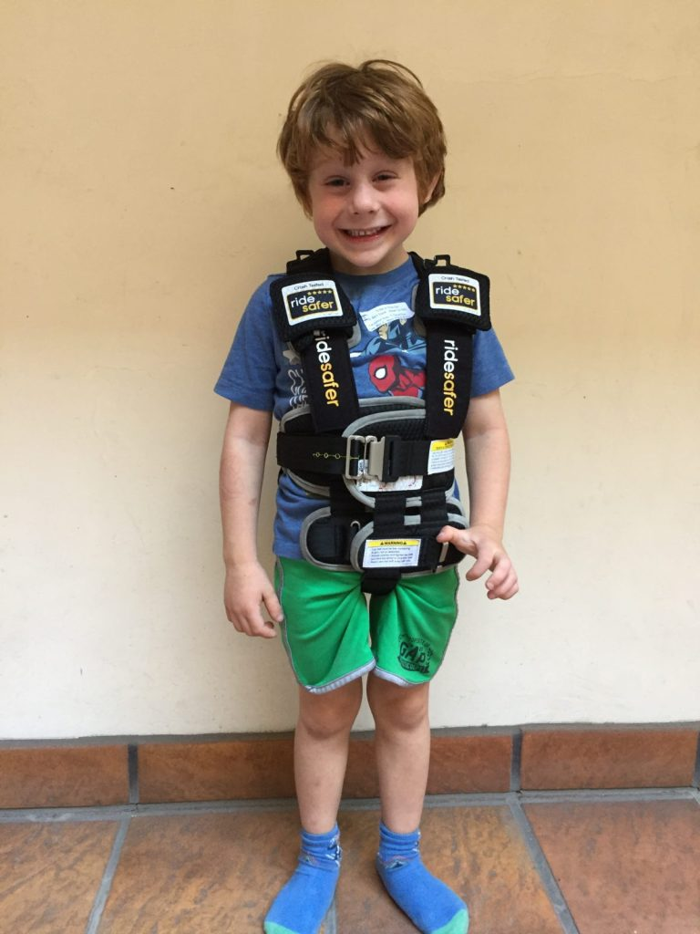 """Ride Safer Delight travel vest on our test model at 41"""" and 40lbs. This picture shows the optional crotch strap in use."""