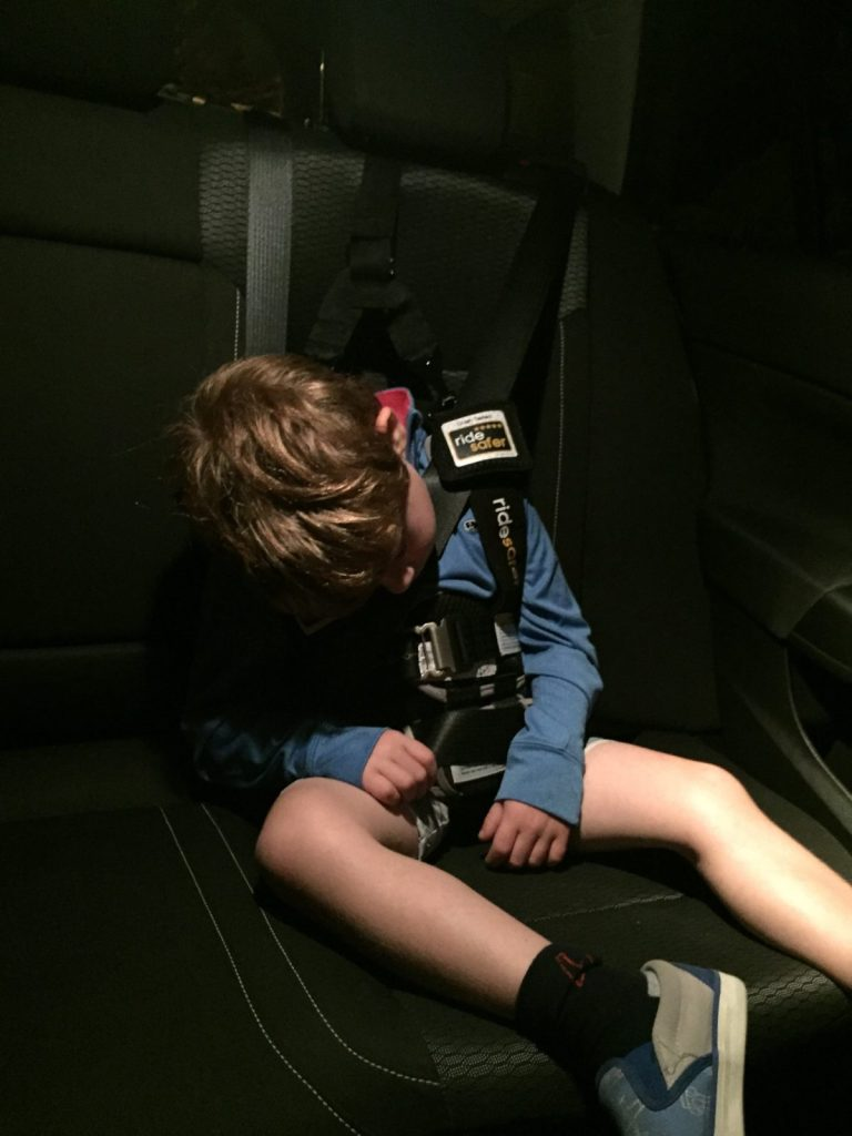 The somewhat rigid torso of the Ride Safer Delight travel vest and the top tether strap minimize slump if your child falls asleep.