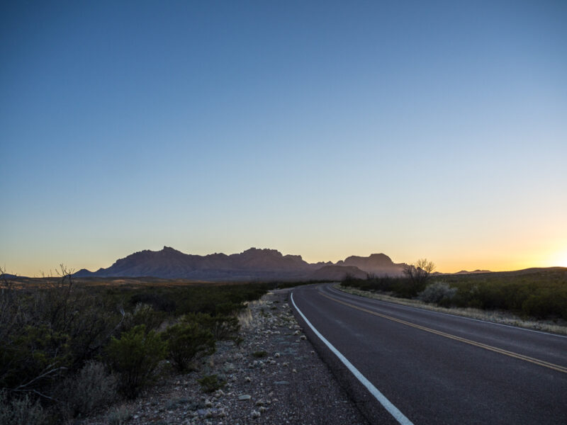 Open road curving toward mountains in Big Bend National Park, Texas