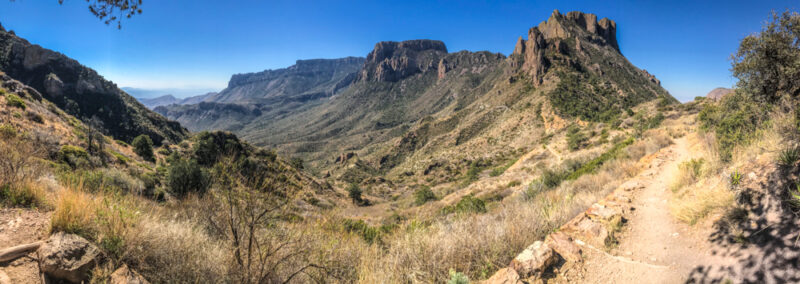 Panoramic view from the top of the Lost Mine Trail in Big Bend National Park, Chisos mountains in background and hiking trail in foreground