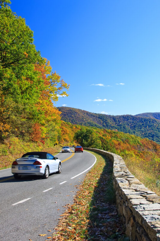white car driving on Skyline Drive in Shenandoah National Park in autumn