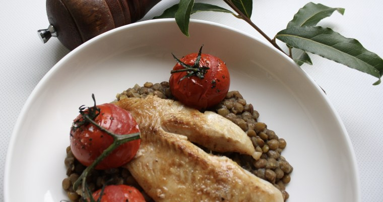 Pan-fried fish with lentils and roasted tomatoes