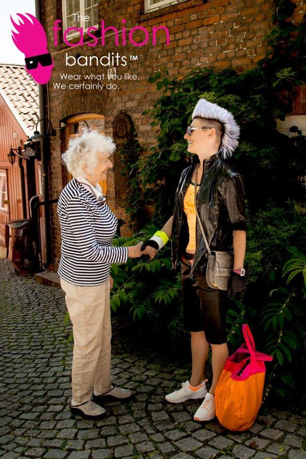 The Fashion Bandits in a neighbourly handshake