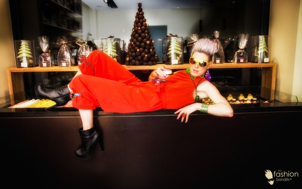 Benedikte St.Pierre of The Fashion Bandits lounging on the chocolate counter