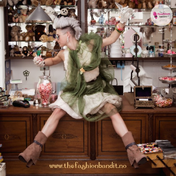 The Fashion Bandit Benedikte St.Pierre is eating sweets in an old fashioned toy shop