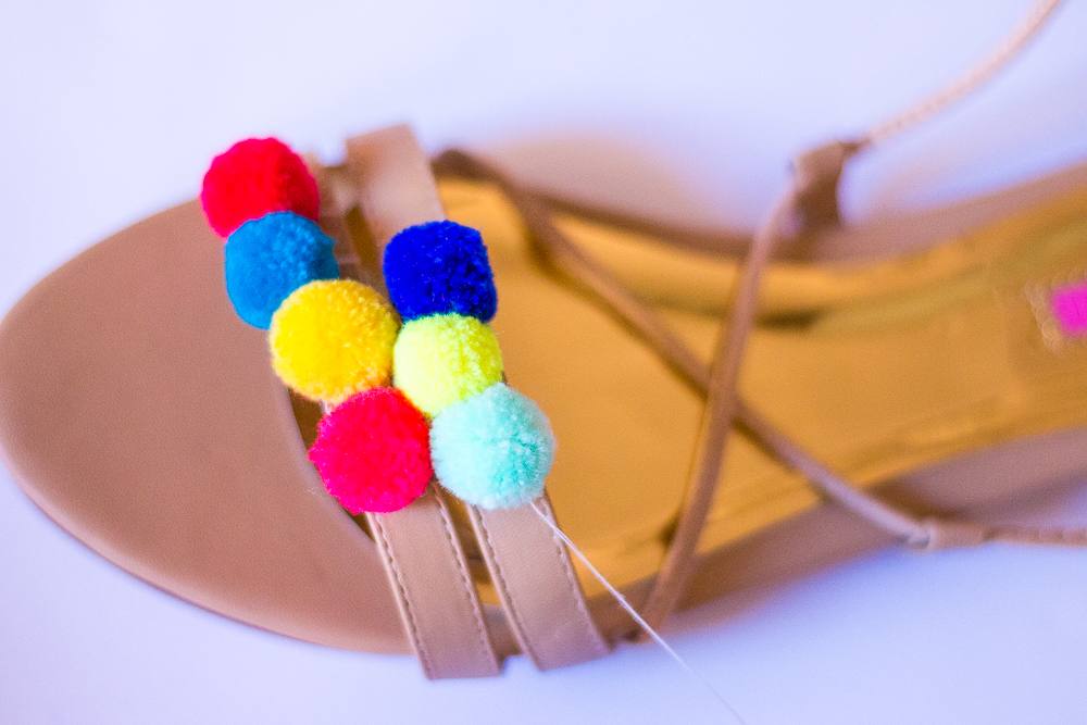 Make sure you have plenty of thread left over to wrap it around the sandal strap a few times and then tie it in a knot.