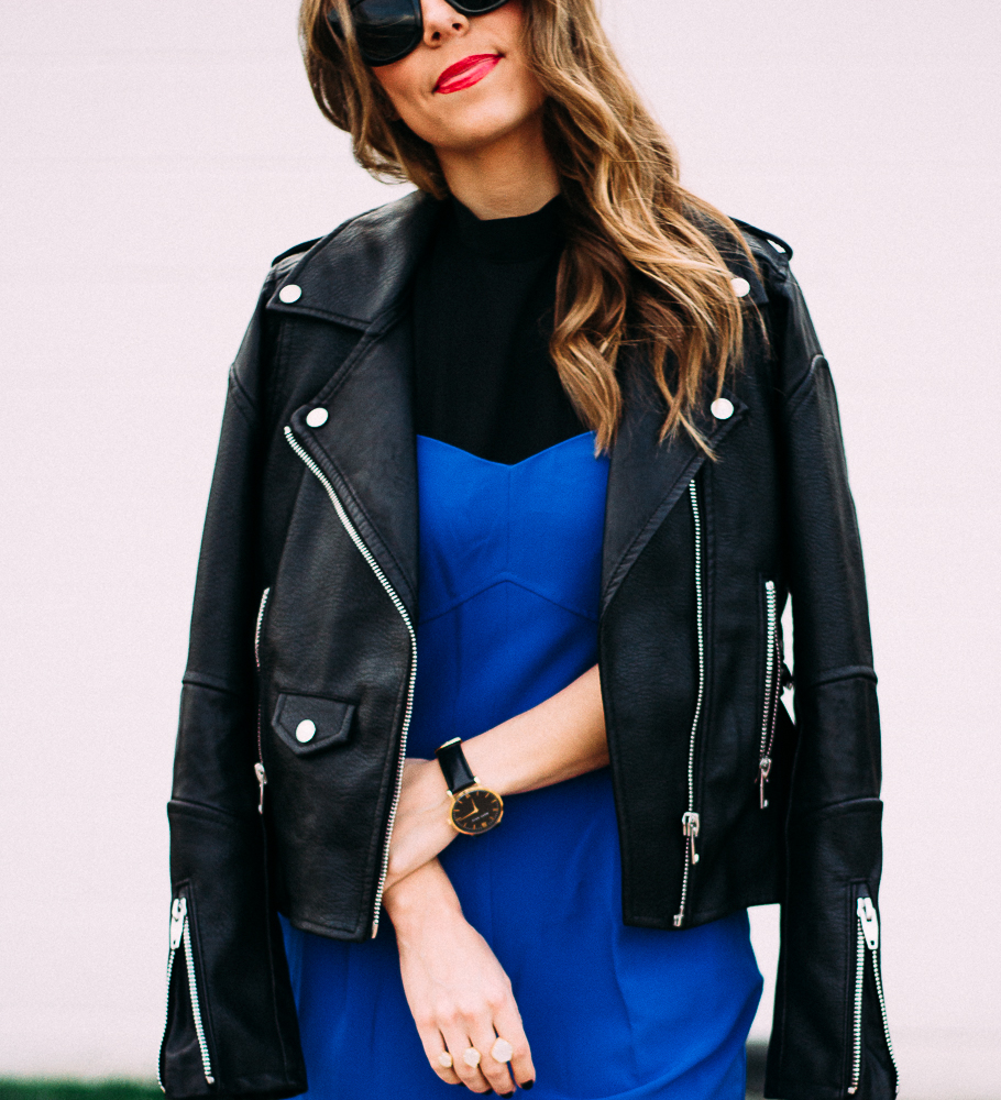 blue jumpsuit with black leather jacket