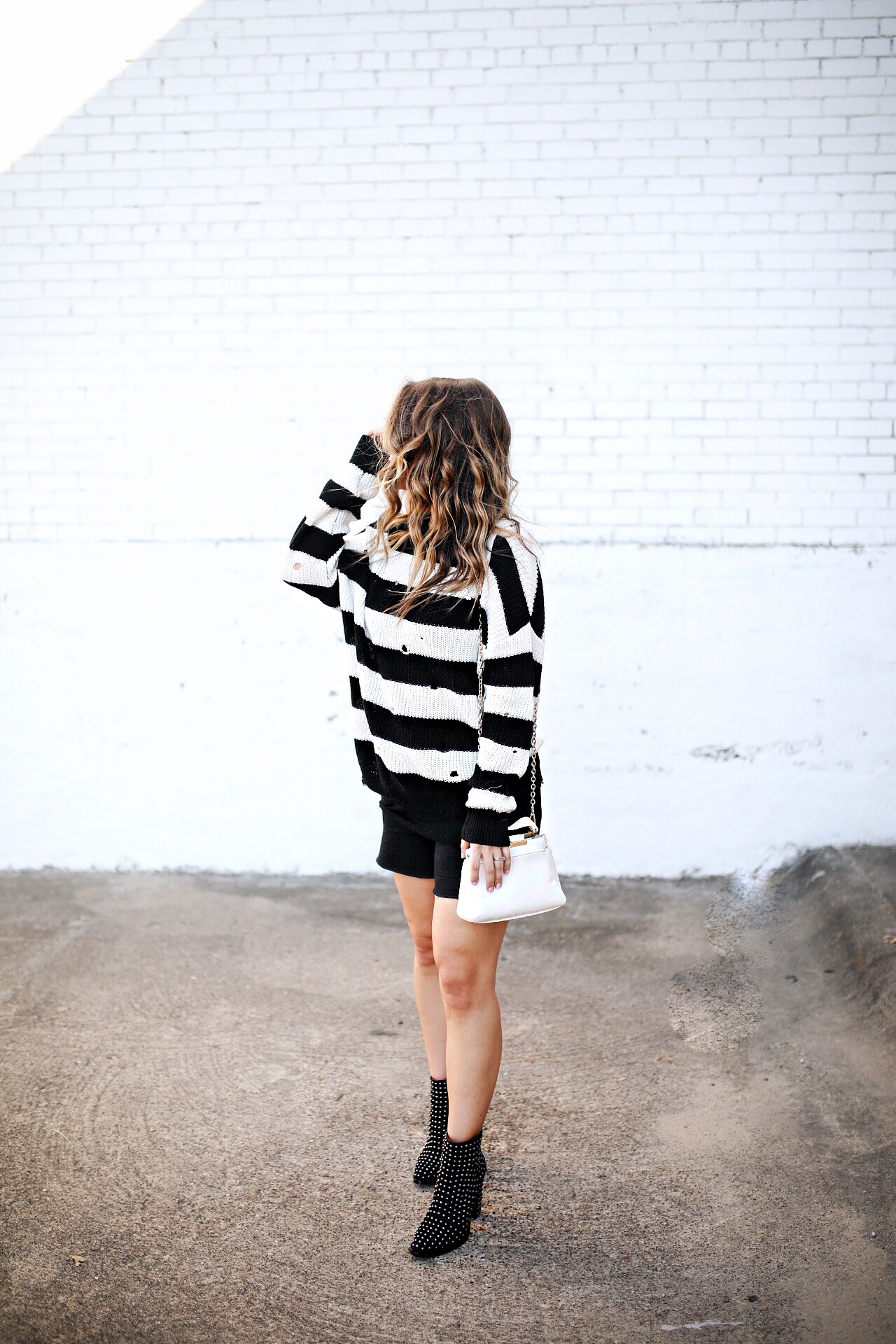 Black and white striped sweater with stud booties