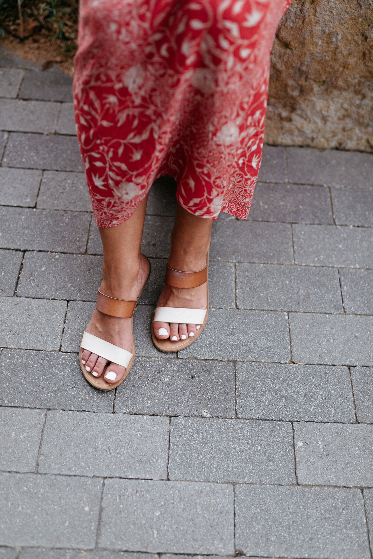 tan and white flat sandals